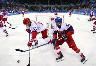 GANGNEUNG, SOUTH KOREA - FEBRUARY 23: The Czech Republic's Michal Repik #62 and Sergei Andronov #11 of the Olympic Athletes from Russia battle for the puck while Bogdan Kiselvich #55 and Vyacheslav Voinov #26 look on during semifinal round action at the PyeongChang 2018 Olympic Winter Games. (Photo by Andre Ringuette/HHOF-IIHF Images)