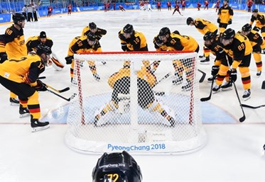 GANGNEUNG, SOUTH KOREA - FEBRUARY 23: Team Germany huddles before taking on Team Canada during semifinal round action at the PyeongChang 2018 Olympic Winter Games. (Photo by Matt Zambonin/HHOF-IIHF Images)